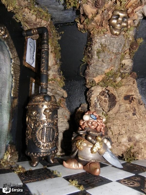 miniature château arbre et Chevalier Bigbidon au chaud devant le poêle à bois